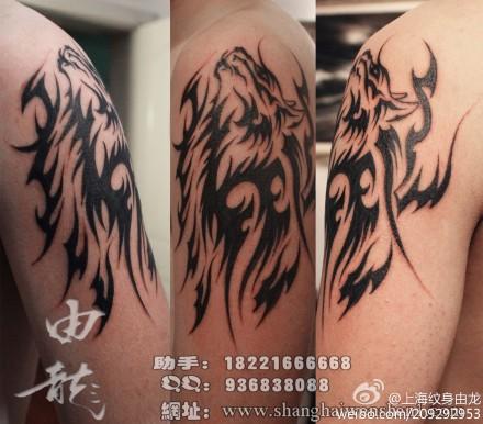 手臂狼图腾纹身