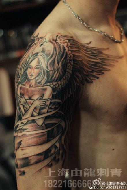 手臂翅膀纹身_中图_上海由龙刺青