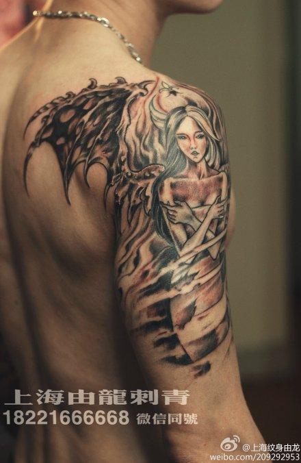 手臂翅膀纹身_大图_上海由龙刺青